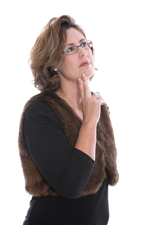 Isolated Middle Aged Businesswoman Looking Pensive And Doubtful